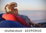 beautiful woman on a yacht with ... | Shutterstock . vector #631953410