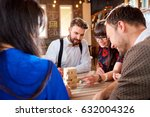 friends play  board games at...   Shutterstock . vector #632004326