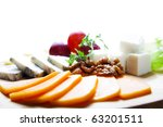 cheese and berry on the kitchen board - stock photo