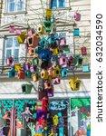 colorful bird feeders hanging... | Shutterstock . vector #632034590