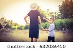 mother with her little son   | Shutterstock . vector #632036450
