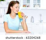 beautiful woman drinks of fresh ... | Shutterstock . vector #63204268