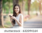thai asian woman using earphone ... | Shutterstock . vector #632094164