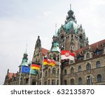 Stock photo new town hall in hannover germany with flags of europe germany lower saxony and hannover city 632135870