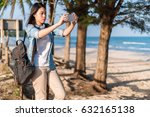 woman traveler sitting on a... | Shutterstock . vector #632165138