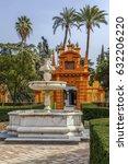 Small photo of Fountain in garden in Alcazar of Seville, Spain