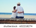 father and son on th beach. | Shutterstock . vector #632218274