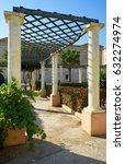 Small photo of The colonnade passageway protected from the sun with pergola in the garden of Villa Bighi (the former Bighi Royal Naval Hospital). Kalkara. Malta
