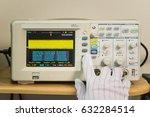 Small photo of Modern oscilloscope, man's hand adjusting wave signals, closeup