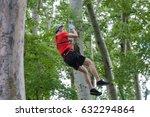 young man on zipline in... | Shutterstock . vector #632294864