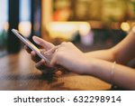hand of woman using smartphone... | Shutterstock . vector #632298914