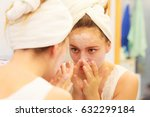 woman applying mask... | Shutterstock . vector #632299184