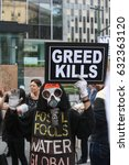 Small photo of NEW YORK CITY - MAY 1 2017: Marches & rallies in support of labor, healthcare & immigrants throughout Lower Manhattan. Anti-pollution activist in costume