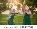 couple having fun  water hose.... | Shutterstock . vector #632369804