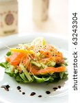 Fresh green salad with smoked salmon,avocado and lemon - stock photo