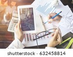 two coworkers working together... | Shutterstock . vector #632458814