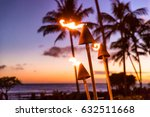 Hawaii Sunset With Fire Torche...