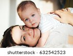 mother and her newborn baby.... | Shutterstock . vector #632542523