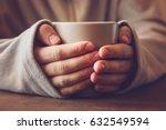 man's hands holding a mug and... | Shutterstock . vector #632549594