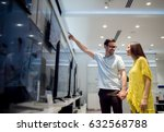 couple at tech store shopping... | Shutterstock . vector #632568788