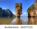 Ko Tapu island in Thailand known as James Bond Island with reflection in water - stock photo