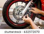 mechanic fixing motocycle  worn ... | Shutterstock . vector #632572070
