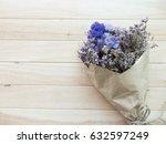 purple of dry bouquet on wooden ... | Shutterstock . vector #632597249