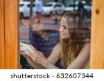 happy couple using smart phone... | Shutterstock . vector #632607344