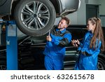 man and woman auto mechanics in ... | Shutterstock . vector #632615678