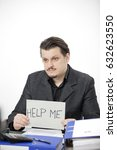 Small photo of An employee wants some help. He is overwhelmed with work.