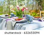 table setting and cage with... | Shutterstock . vector #632653094