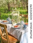 table setting and cage with... | Shutterstock . vector #632653190