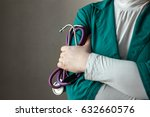 doctor in green uniform with... | Shutterstock . vector #632660576