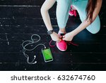 runner woman tying running... | Shutterstock . vector #632674760