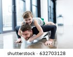 man doing push ups with boy on...   Shutterstock . vector #632703128