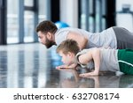 man and boy doing push ups at... | Shutterstock . vector #632708174