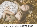 mother and daughter lying on on ... | Shutterstock . vector #632725688