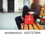 Woman Sitting On The Bench Wit...