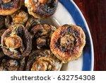 whole mushrooms roasted on a...