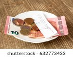 close up of plate with bill and ... | Shutterstock . vector #632773433