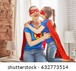 mother and her child playing... | Shutterstock . vector #632773514