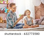 happy loving family. father is... | Shutterstock . vector #632773580
