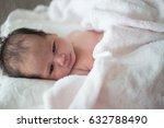 sleeping newborn baby in a wrap | Shutterstock . vector #632788490