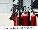 red tank of fire extinguisher | Shutterstock . vector #632791358