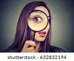 curious woman looking through a ... | Shutterstock . vector #632832194