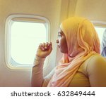 arabic girl in the airplane | Shutterstock . vector #632849444