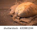 single bread on wooden...   Shutterstock . vector #632881244