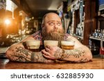 pensive male embracing mugs of... | Shutterstock . vector #632885930