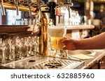 Small photo of Male arm keeping pouring beer in alehouse