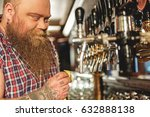 Small photo of Smiling fat man cleaning equipment in alehouse
